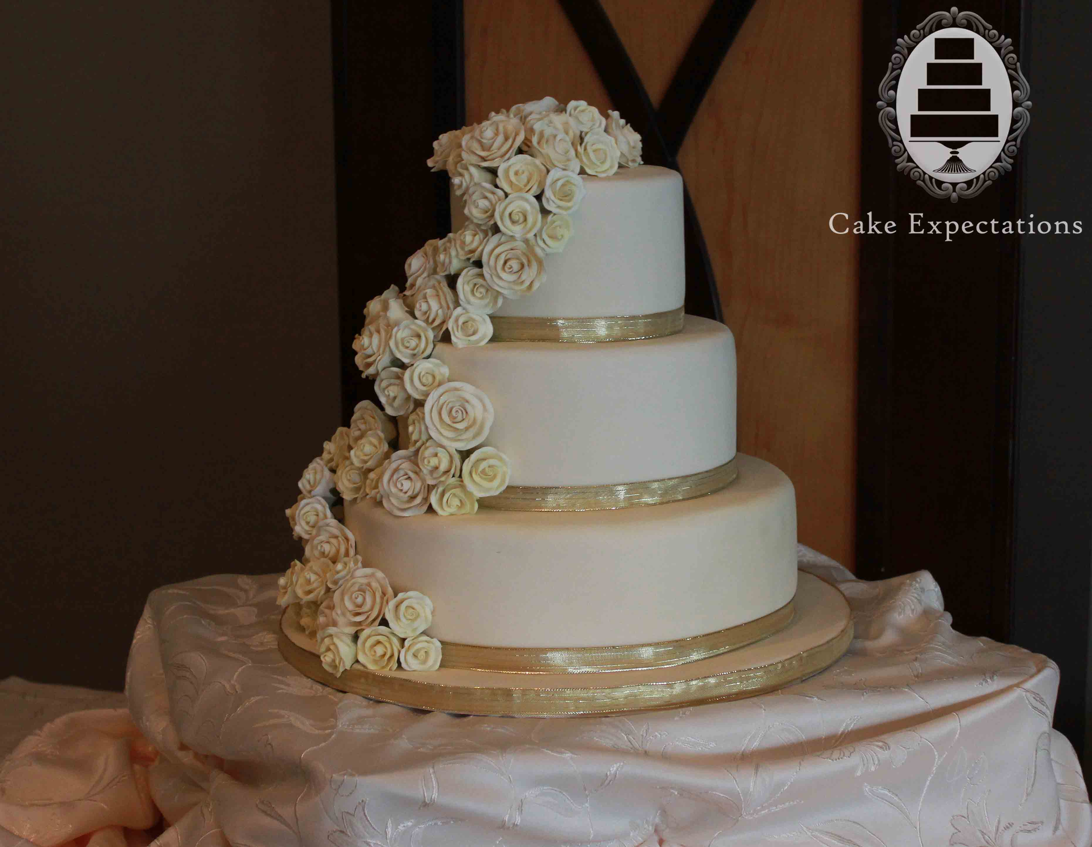 White And Gold Rose Wedding Cake